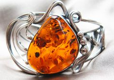 Beautiful and powerful Amber on a nice ring. Amber : Good Luck Stone and A Negative Energy Transformer Amber Earrings, Amber Bracelet, Amber Jewelry, Gemstone Jewelry, Jewelry Rings, Silver Jewelry, Jewlery, Bracelets, Diamonds