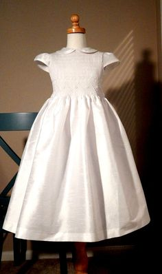THIS DRESS WILL BE AVAILABLE IN ABOUT 3 WEEKS ( 3/14/15) PLEASE CONTACT US FOR ANY QUESTION. Beautiful hand smocked heirloom First Holy Communion