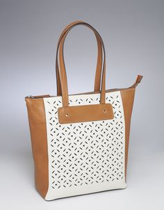 This soft and smooth American cowhide concealed-carry tote has a unique, two-tone, cut-out design on the front panel, in a bone and warm tan color combination.