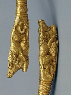 SCYTHIAN GOLD BRACELET, MEOTIAN CULTURE, LATE 4TH CENTURY BC  At each of the torque's ends can be seen a lion holding a tusked boar by the back of the neck. Found in the Karagodeuashkh Barrow, Kuban, Krasnodar Region, Ukraine.