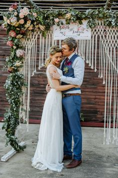 The DIY macrame and floral ceremony arch is a bohemian wedding dream come true