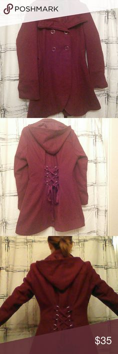 Gorgeous Burgundy Wine Wool Coat With Corset Back Love this maroon wool-poly blend coat! Bought online, but too large for me :( Beautiful tulip hem with corset back. Detachable hood. Excellent used condition. I've worn this on a couple of winter vacations back East (NY & PA). Fully lined and very warm!  Please use offer button, not comments, for all price inquiries :) happy poshing! Charlotte Russe Jackets & Coats Pea Coats