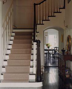 Rich dark floors reflecting back the light, grounding the room.