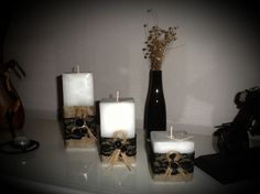 White scented candles with black lace, burlap and black buttons