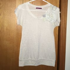 Cute top Cute  cream/white top with flower on the upper left shoulder. It is a little sheer so I would recommend wearing a tank top under it. Julie's closet Tops Tees - Short Sleeve