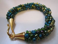 Blues Turquoise Greens Gold kumihimo beaded by CarolBeckDesigns