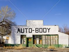 auto-body shop - A run-down and abandoned Auto-Body Shop found in Keeler, California under a blue sky.