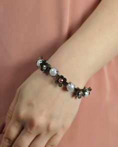 $70 Cooper Swarovski Crystals Pearly Floral Bracelet by Miss Julie  Shop here: http://www.trendcy.com/cooper-swarovski-crystals-pearly-floral-bracelet/