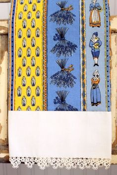 Tea Towel Quimper Inspired Vintage fabric with antique lace trim Blue and Yellow. $20.00, via Etsy.