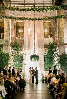 15 Gorgeous Indoor Wedding Backdrops To Try An Ethereal Curtain Lots Of Greenery Around And Chandliers Completely Change The Venue