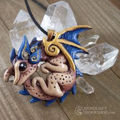 Coiled dragon pendant with blue accents and antiqued details. Available now in the shop!