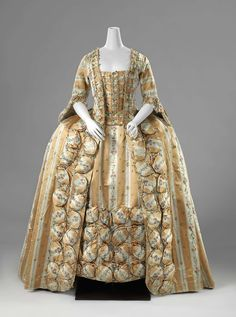 Robe à la francaise, probably France, c. 1770. Yellow and white striped silk, embroidered with flower sprays and a vertical pattern of floral bouquets, lined with multicoloured chiné la branche, fabric trimming.