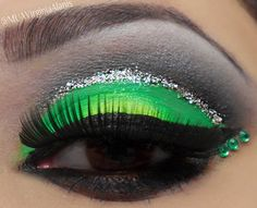 Green With Envy. Green and silver eye makeup. Black shadow, green eyelid, glitter, santee lip liner, hard candy in queen lip gloss