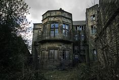 Rear view of Winstanley Hall, known by some as Poseidon Hall, was built in a Tudor style in the 16th Century for a wealthy family. Several extensions were added since the original build most notably in the early 1800′s when it was altered extensively into a Jacobean style. The Hall was abandoned in the 1960′s and has fallen into serious disrepair.  Winstanley, in the Metropolitan Borough of Wigan, U.K.