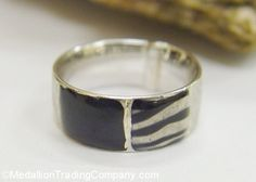 14k White Gold Black Enamel 7mm Wide Ring Animal Zebra Print Satin Polish Size 5 -----$149.95 MedallionTradingCompany.com  Measurements: 7mm all the way around  Ring Size: 5, cannot be resized  Total Weight: 1.6 grams  Markings: 14k, Italy  Metal: 14k white gold, marked and tested