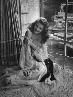 Actress Rita Hayworth Wearing Nude Souffle Negligee in movie