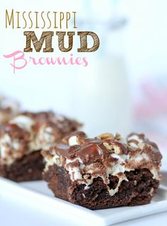 Mississippi Mud Brownies Recipe.   Topped with mini marshmallows, chopped pecans, and a poured fudge frosting.  These are SO yummy and look gorgeous!!
