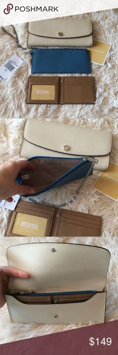 NWT Michael Kors Juliana Wallet %100 Authentic Guaranteed. Brand new with tags still attached this is the newest collection from Michael Kors this wallet is so amazing it fits everything and has room for a iPhone 6 Plus can also be worn as a wristlet. Currently SOLD OUT in this color. I have one in black I am keeping that I bought two so I am deciding to sell this one. NWT.Make An Offer Michael Kors Bags Wallets