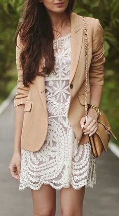 Cream lace dresses get a more structure look with a light blazer.