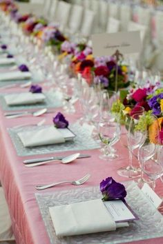 Blush linens with textured frosted chargers and silver flat ware create a lovely table top design. Purple flowers and a gorgeous menu can add to an already stunning table for a California Wine Country wedding.