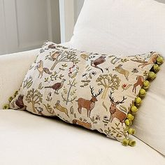 £65 Redolent of 15th century tapestries woven in Flanders and depicting woodland scenes. Linen mix cushion embroidered with woodland animals and trees.