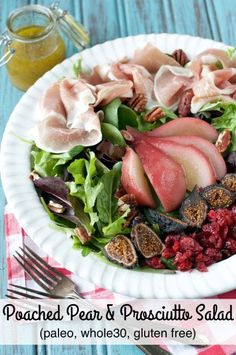 Paleo Poached Pear and Prosciutto Salad combines cinnamon-vanilla poached pears, thinly sliced prosciutto, dried figs and cranberries on a bed of mixed greens with a drizzle of white balsamic vinaigrette for a delicious gluten-free and whole30 dinner salad!