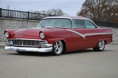 1956 Ford Fairlane Club Victoria with door handles and ornaments removed. One like this in black with a mid-'60s SOHC 427, 6-spd .5:1 top gear trans and 4:56 9-inch diff, sitting on an Art Morrison chassis, is my ultimate wish.