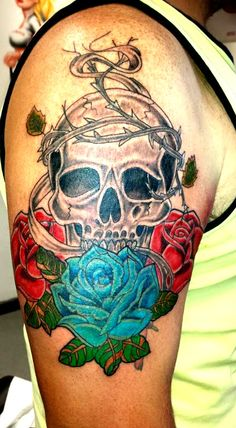 Skull with roses done by one of the artists here at sin on skin