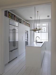 Yotam Ottolenhi's kitchen, Roundhouse kitchens, beautiful brass pendant lighting, white, floorboards