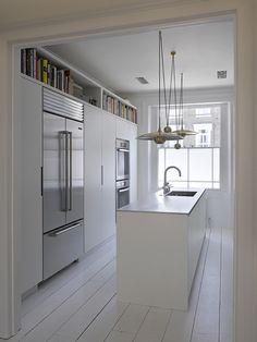 Yotam Ottolenhi's kitchen, Roundhouse kitchens, beautiful brass pendant lighting, white, floorboards