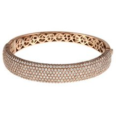 Rose Gold over Sterling Silver Clear Cubic Zirconia Bangle Bracelet  @Overstock - This bangle bracelet shines with clear cubic zirconia stones pave-set across the front. The bracelet is crafted of sterling silver with rose gold plating and a highly polished finish.http://www.overstock.com/Jewelry-Watches/Rose-Gold-over-Sterling-Silver-Clear-Cubic-Zirconia-Bangle-Bracelet/5911180/product.html?CID=214117 $269.99