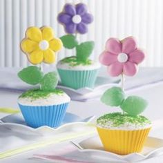 Pick to Click Cupcake - Bright flower-topped cupcakes shout that spring has sprung! Create the cookies with Flower Cut-Outs, attach to a lollipop stick stem and add jelly spearmint leaves for a tasty trim. Wilton Cupcakes, Fancy Cupcakes, Wilton Cake Decorating, Cake Decorating Tools, Decorating Ideas, Rose Icing, Flower Cut Out, Icing Colors, Candy Cakes