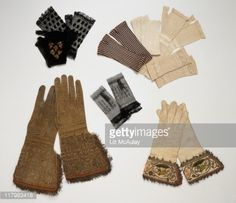 A selection of antique gloves including gauntlet gloves from 17th century and mittens from around 1835