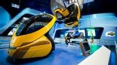 Parts of a futuristic yellow car on display at 'Test Track Presented by Chevrolet' at Epcot