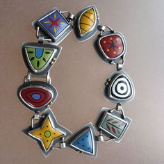 Kimberly Keyworth bracelet with enamel work---taboostudio.com. This reminds me of Fordite, which I recently saw in Idaho Falls.