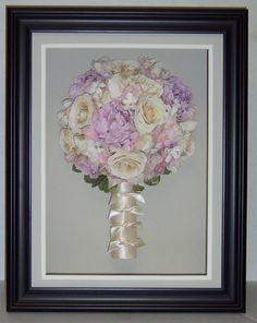 Joan framed her beautiful bouquet with grey matting and a black frame. A narrow double window mat  surrounds her flowers. Simple and Classic!