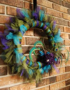 Peacock Tulle Wreath - Reception decorations? With letter of last name in the middle? Maybe blinged out?