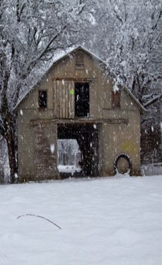 Snowing On Yellow Barn
