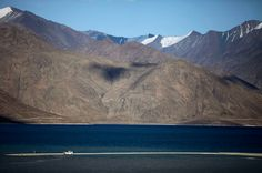 Tourists park on a strip of land at the Pangong Lake, near the India-China border in Ladakh, India. Ladakh is a remote part of the former princely state of Kashmir. While Kashmir is best known for the Indo-Pakistani standoff, part of Ladakh, an ethnically distinct region with historical ties to Tibet, has been controlled by China for decades.