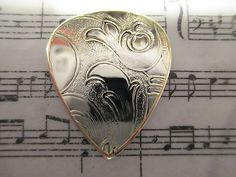 Silver and Brass Guitar Pick!