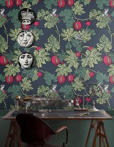 The eye-catching Frutto Proibito Wallpaper by Cole & son beautifully combines different Fornasetti motifs from the archives of the and Cheeky monkeys perch in the pomegranate tree branches. Moody Wallpaper, Cole And Son Wallpaper, Wallpaper Decor, New Wallpaper, Print Wallpaper, Cloakroom Wallpaper, Beautiful Wallpaper, Animal Wallpaper, History
