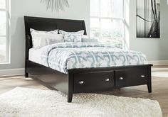 Braflin Black King Storage Sleigh Bed  The Braflin king storage sleigh bed has the earmarks of transitional furniture—a clean, classic design with a fresh sensibility. Drawers are adorned with a crisp pairing of knob-and-pull hardware in a nickel-tone finish. Here's a look that can work in any setting. *Image shown is a queen size bed.