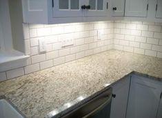 white subway tile backsplash with venitian gold granite countertops. White Granite Kitchen, White Granite Countertops, Kitchen Countertops, Kitchen Cabinets, White Kitchens, Beach Kitchens, Open Kitchens, Bathroom Cabinets, New Venetian Gold Granite