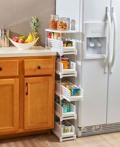 Small Kitchen Remodeling This Slim Sliding Drawer Storage unit is a simple organizational solution for small spaces. Each removable drawer slides out for easy access to the items inside. It's ideal for holding smaller items…More Space Saving Kitchen, Small Kitchen Organization, Small Kitchen Storage, Storage Spaces, Storage Ideas, Organization Ideas, Small Space Storage, Bathroom Storage, Hidden Storage