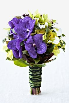 Bright & Vibrant Wedding Flowers: Clustered posy of green cymbidium, slipper and purple vanda orchids, hot chocolate calla lily and cordyline leaf. Available in winter and spring by Flos Florum. Vanda Orchids, Wedding Flowers, Wedding Dresses, Yellow Wedding, Calla Lily, Corsage, Vibrant, Bright, Slipper