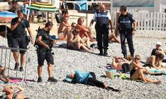 Police with woman on beach - Provided by Guardian News