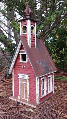 Antique red school bird house with bell tower.  Steep pitched roof.  Slat walls.  Lots of interesting details give this charm!