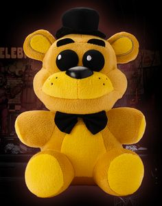 The Golden Freddy plush is bright yellow with black eyes, black bow tie, and black top hat.