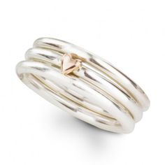 A slimline sterling silver stacking ring handmade in our Hove workshop accented with a solid gold heart - choose either yellow or rose gold.  This stacking ring is available in a range of sizes - stack them together with our beaded stacking rings in your own combination to create an original set of contemporary rings you will wear with everything.