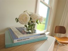 White roses from our front garden in a clear Iittala Alvar Aalto vase in a quiet corner of our Cape Cod dining room.